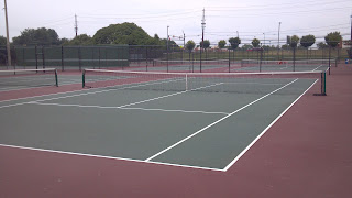 several green and red tennis courts