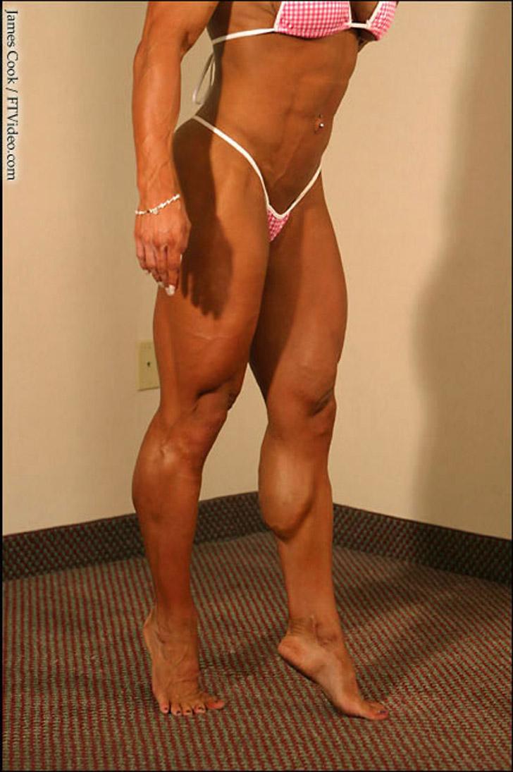 Amanda Dunbar Flexing Her Muscular Calves In A Bikini