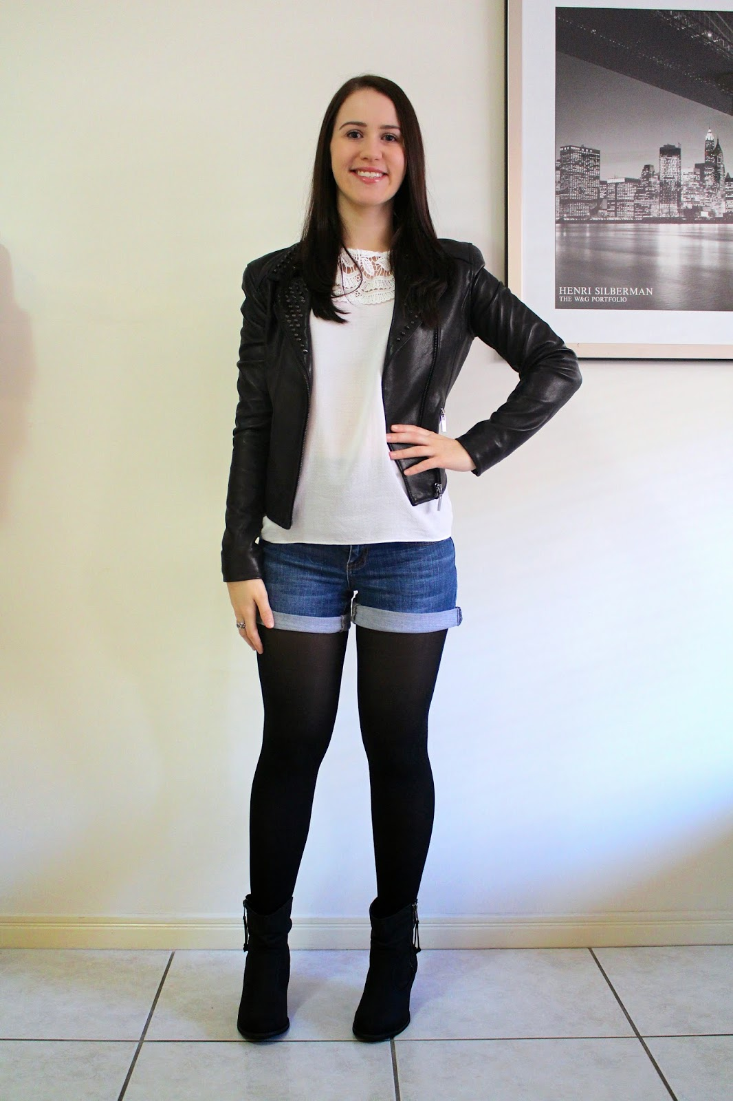 Denim shorts, black opaque tights, white lace top, black studded leather jacket, black booties, mixed metal rings, everyday outfit, nighttime outfit, petite girl outfit, denim shorts and tights outfit, leather outfit