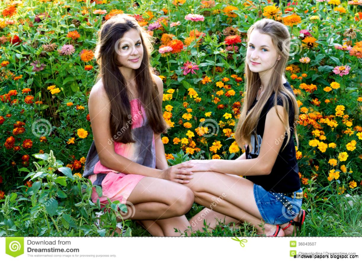 Teen Girls On Background Of Flowers Royalty Free Stock Photography