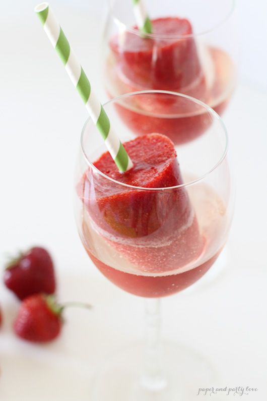 Strawberry popsicles and prosecco make for a refreshing summer drink!