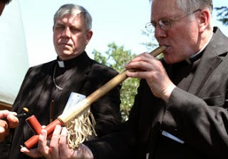 Pax217 band name explanation - Archbishop Listecki smokes peace pipe