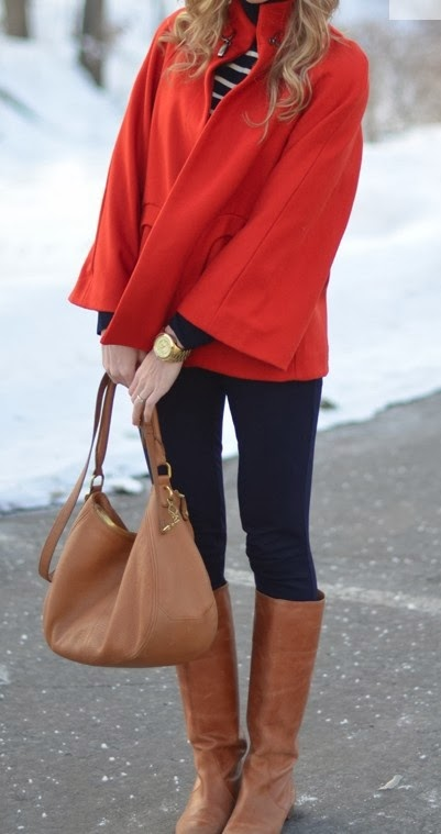 Adorable red jacket, white lined sweater, black pants and brown long boots with brown purse for fall