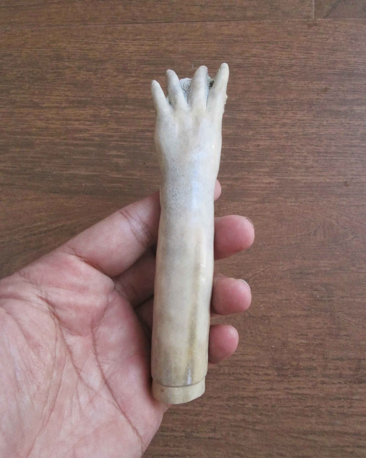 Hand Carved Hand Holds Woman Handle in Antler