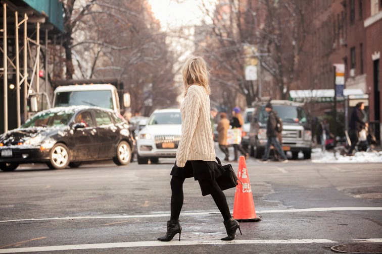 In motion, city streets, skirt + chunky knit, single sole booties, NYC, messy hair, turtleneck, photo by Ian Rusiana