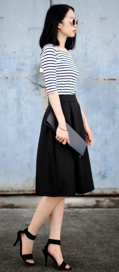 Parisian Chic wearing a Striped Top and Midi Skirt