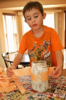 preschool child adding tissue paper