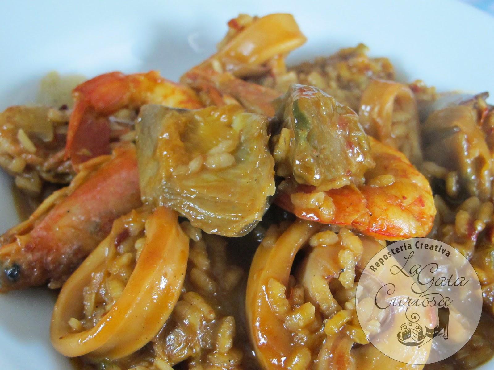 http://www.lagatacuriosa.com/2014/01/arroz-cremoso-con-calamares-gambas-y.html