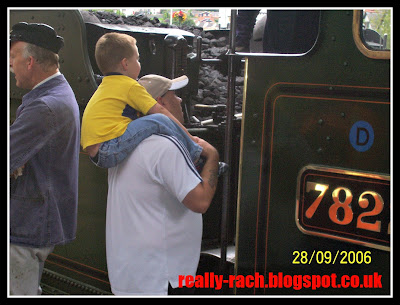 Really Rachel looking at the drivers plate at Llangollen Railway