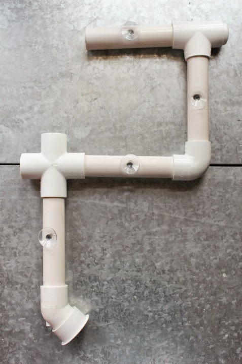 connecting DIY bathtub water park pieces 1