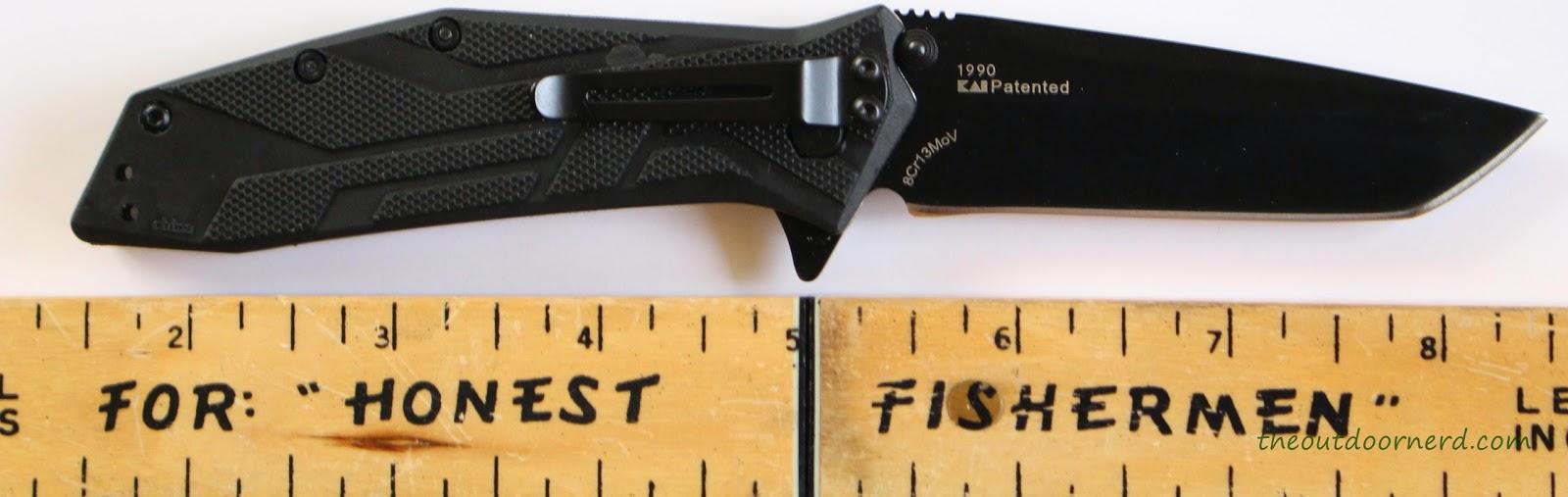 Kershaw Brawler Pocket Knife Next To Ruler