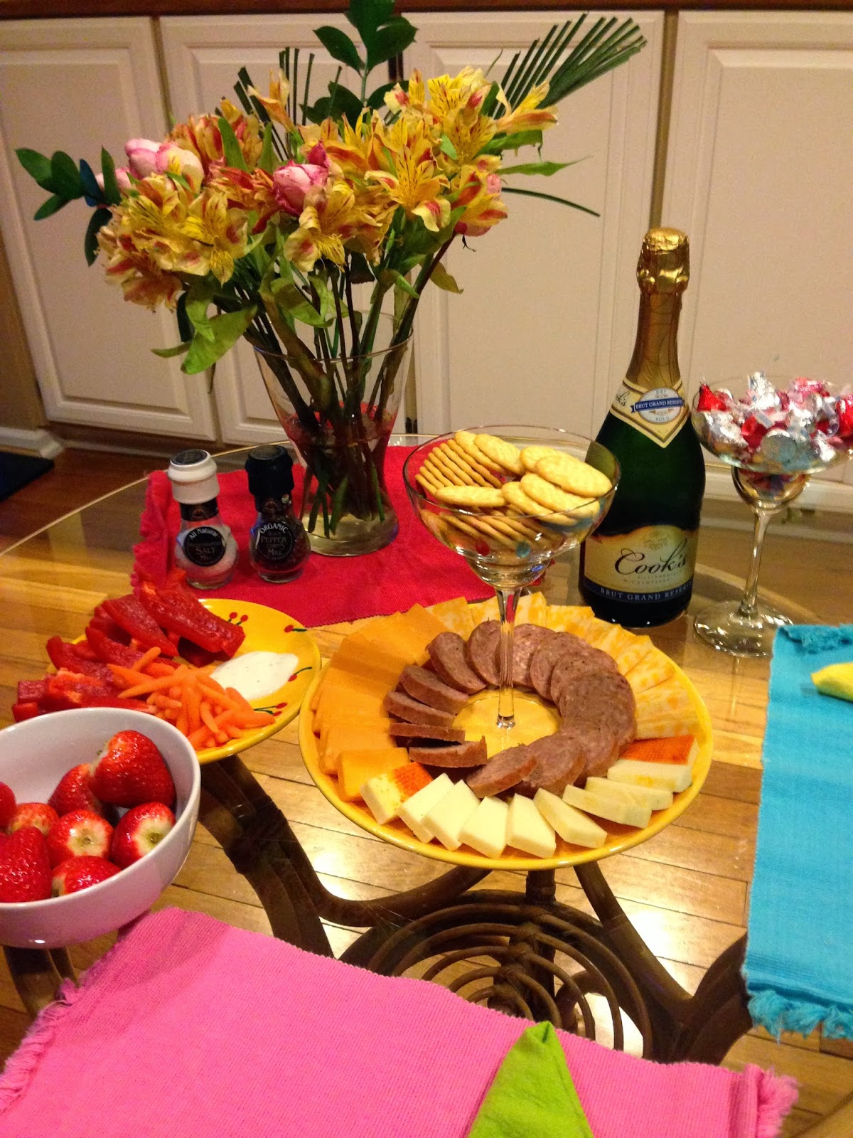 Fruit, veggies, meat, cheese, & crackers, sparkling wine, and chocolate