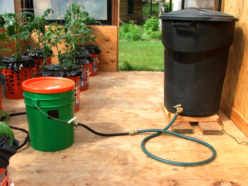The Float Valve Regulator in the green bucket is connected to a 35 gallon gravity feed reservoir made from an inexpensive plastic trash container