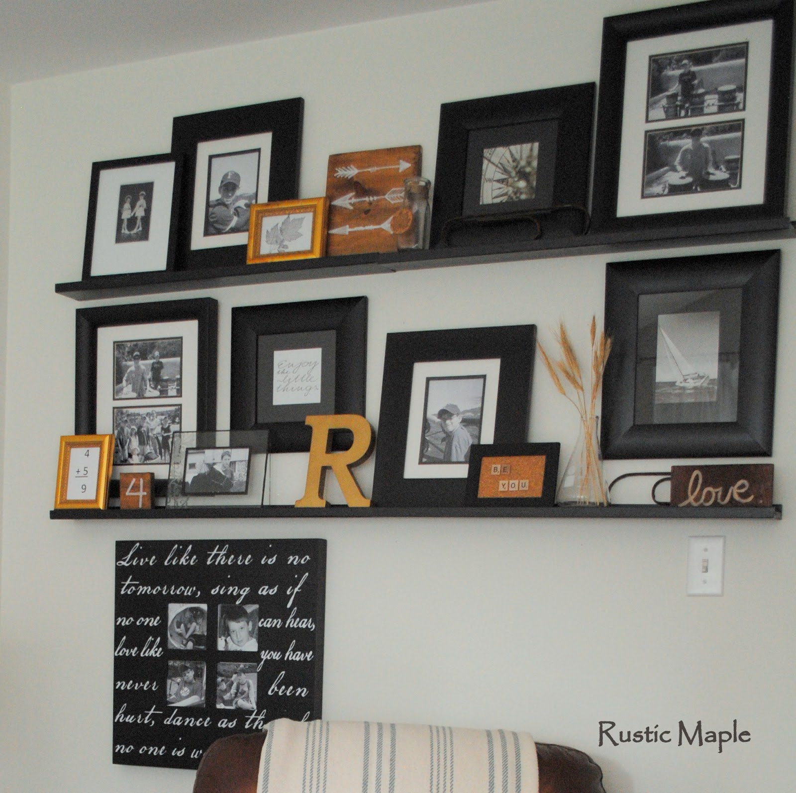 Rustic maple family room gallery wall with picture ledges for Family room photo gallery