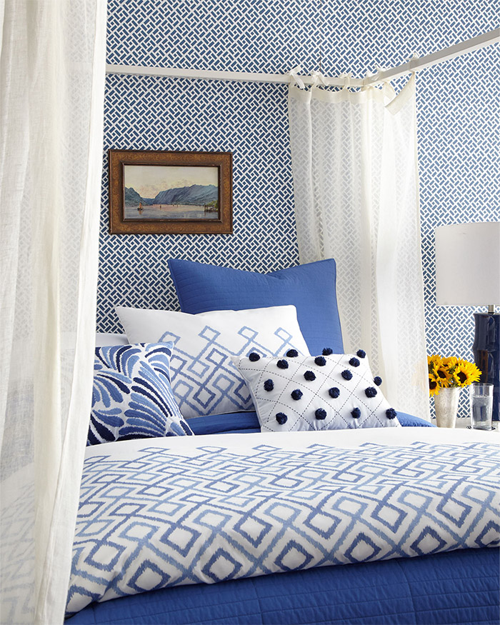 Blue and white plus fun patterns combine to create this fantastic bedroom.