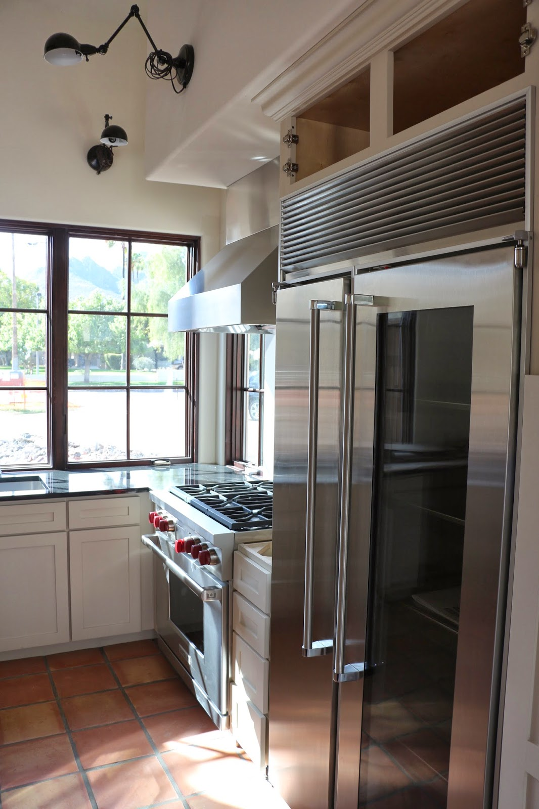 wolf stove with red knobs, marvel refrigerator, proline prov hood