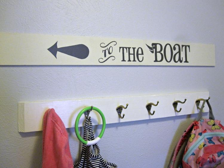 Mudroom sign above coat hooks