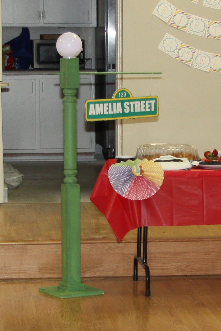 Living joyfully amelias second sesame street birthday party one of my favorite projects was the sesame street lamp post because what is sesame street light i used this tutorial it hangs out in our bonus room now aloadofball Choice Image
