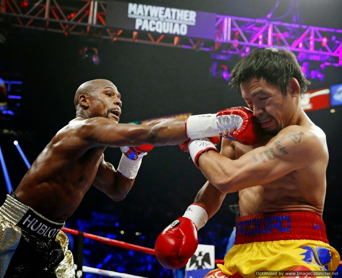 See the fight between Floyd Mayweather vs Manny Pacquaio in pictures
