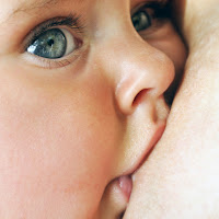 image Blue eyed baby breast feeding