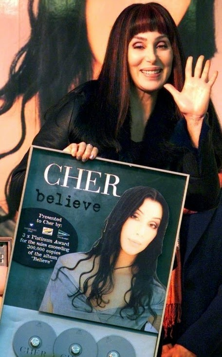 Cher with a certification plaque