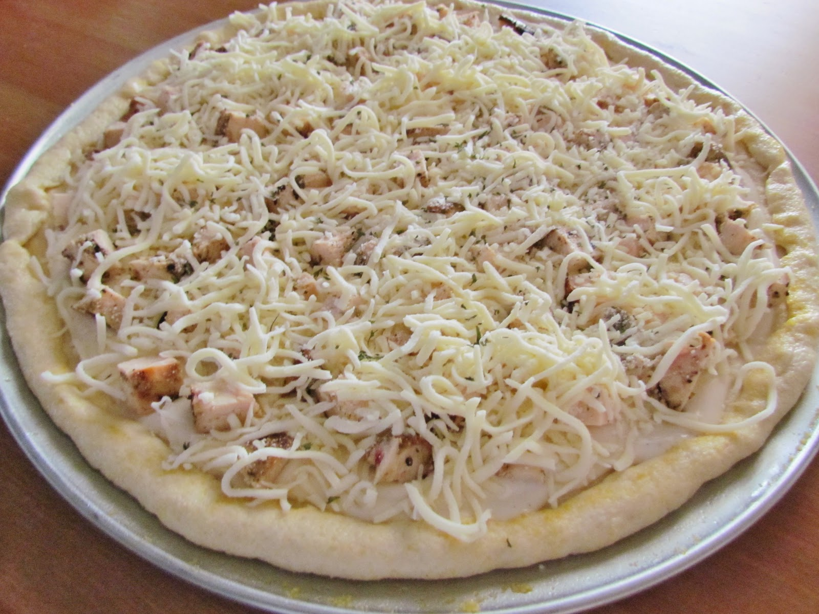 ... pizza recipe I'm using here is for the Grilled Chicken Alfredo Pizza