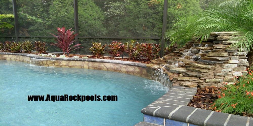 Aquarock pool waterfalls orlando tampa for Natural rock swimming pools