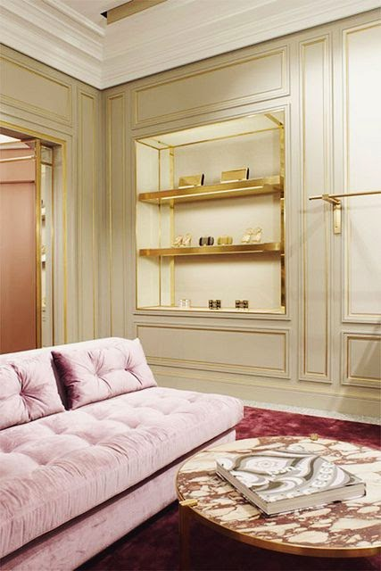 white room with gold accessories gold bookcases