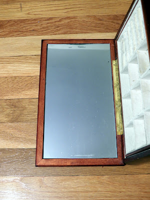 Mirror inside the jewelry box lid