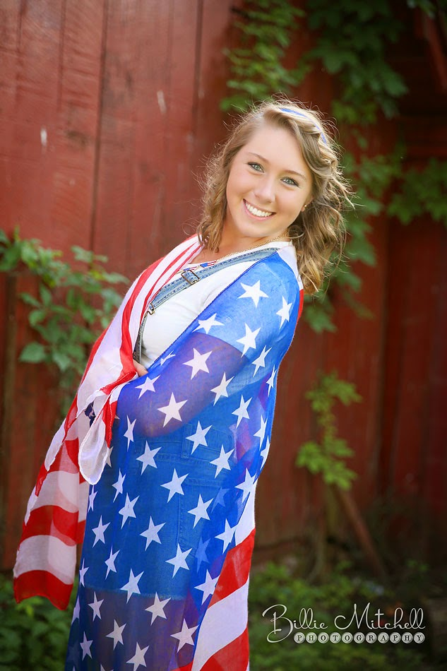 senior girl wrapped in american flag scarf
