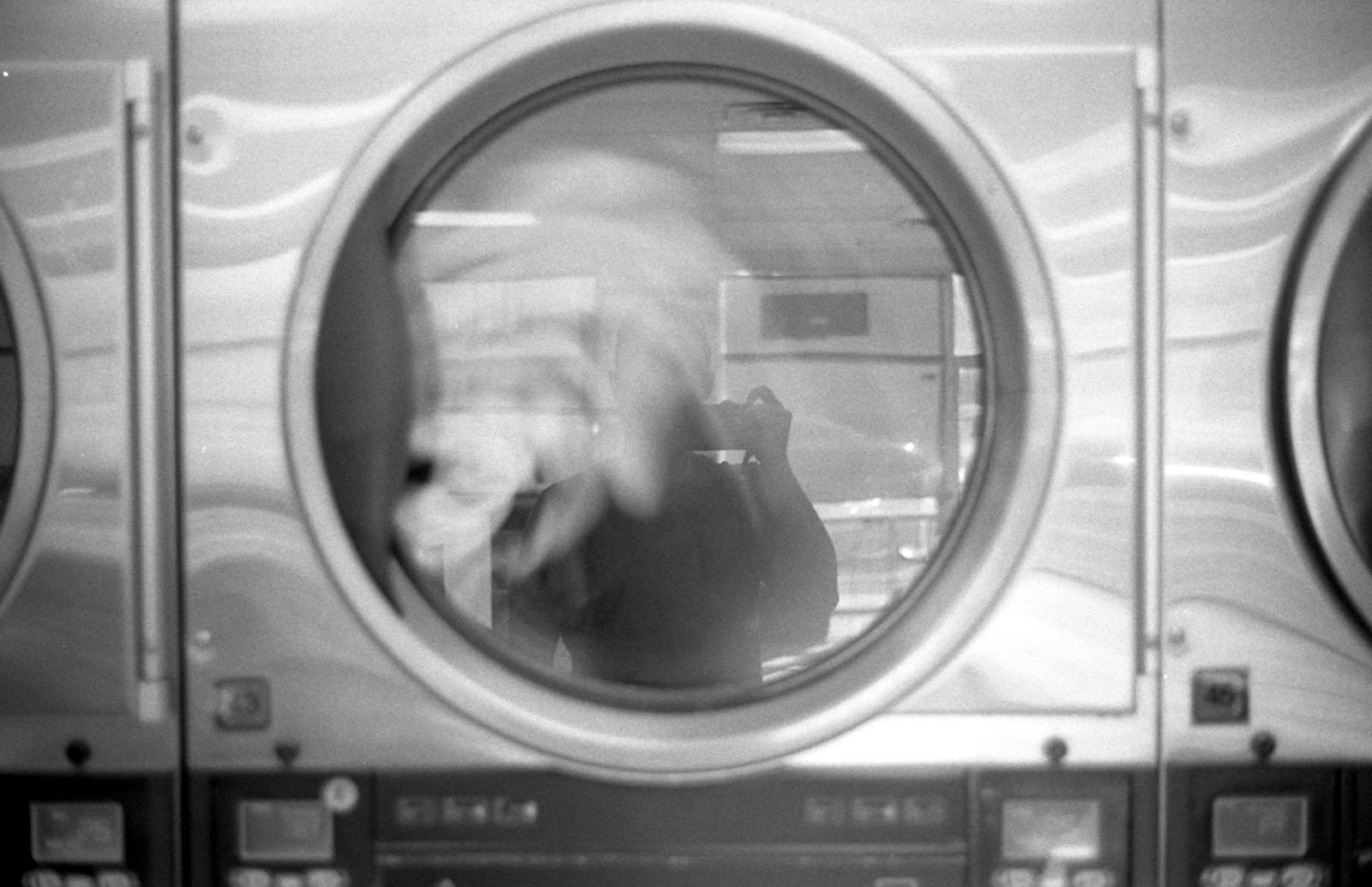 Laundromat self portrait in front of spinning laundry