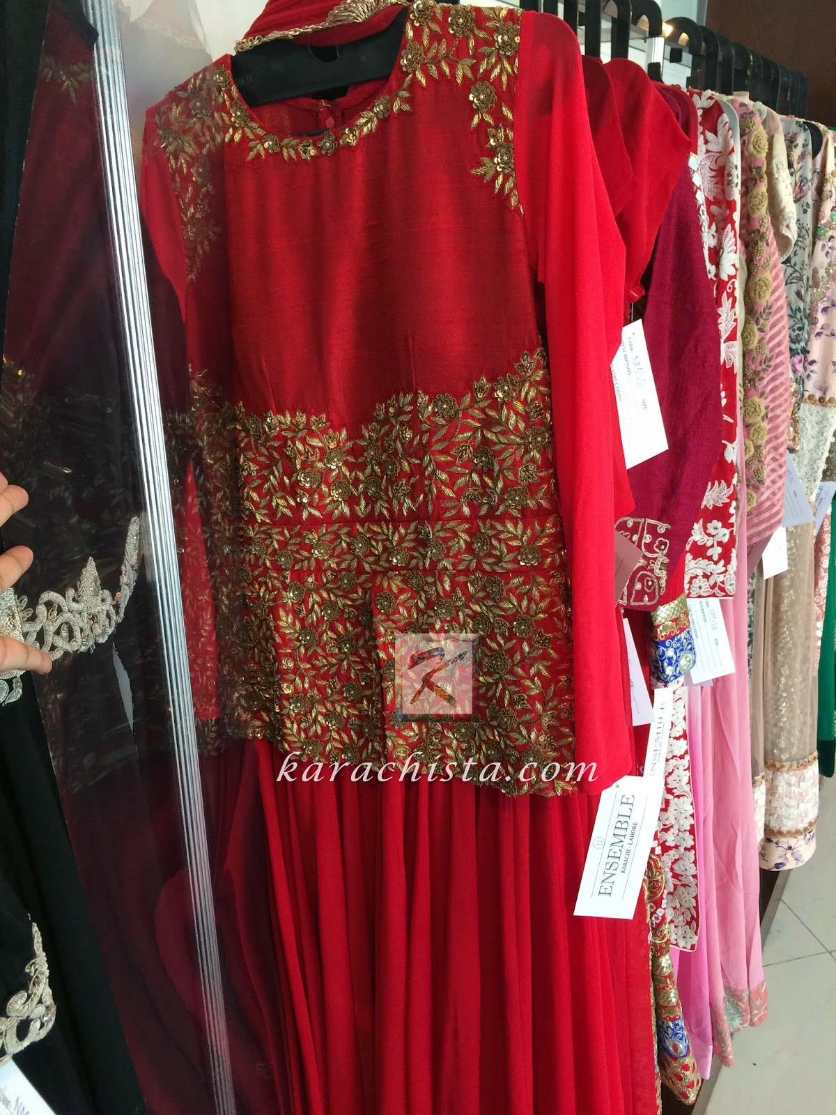 Red wedding outfit by Indian designer Nishi Mehra at Ensemble Karachi