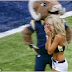 Cheerleader Drops Everything After Seeing Commotion In The End Zone [VIDEO]