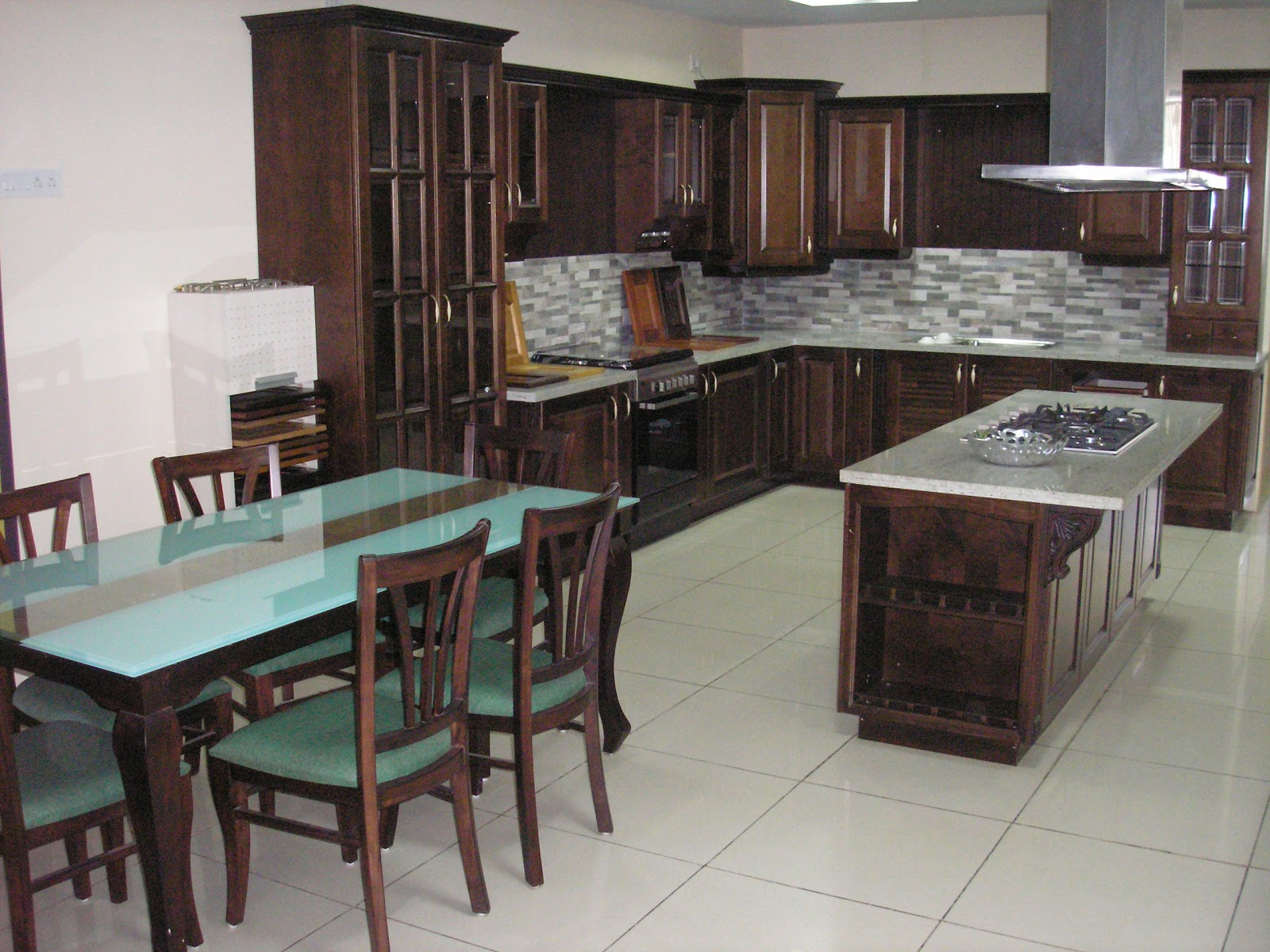 Walnut Modular Kitchen With A Solid Wood Dining Set On Display At IKI  Bangalore