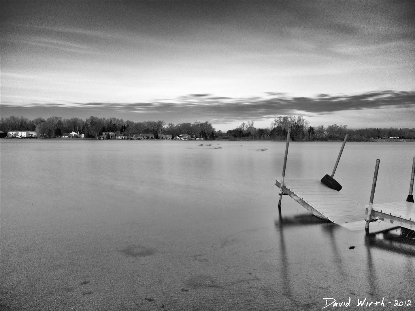 ND filter at the lake, calm lake water, smooth, dock, black and white, effect, photography