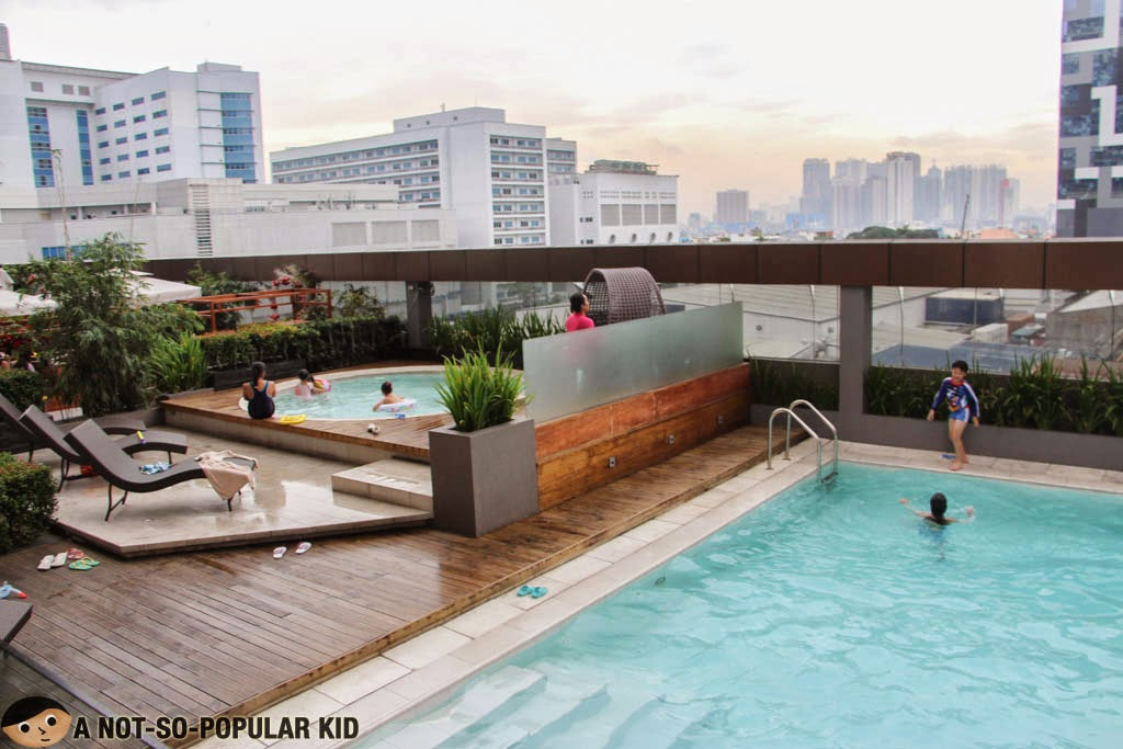 Child-friendly pools of F1 Hotel Manila with an amazing view of the Bonifacio Global City