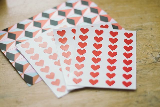heart stickers and holographic postcard from tiger