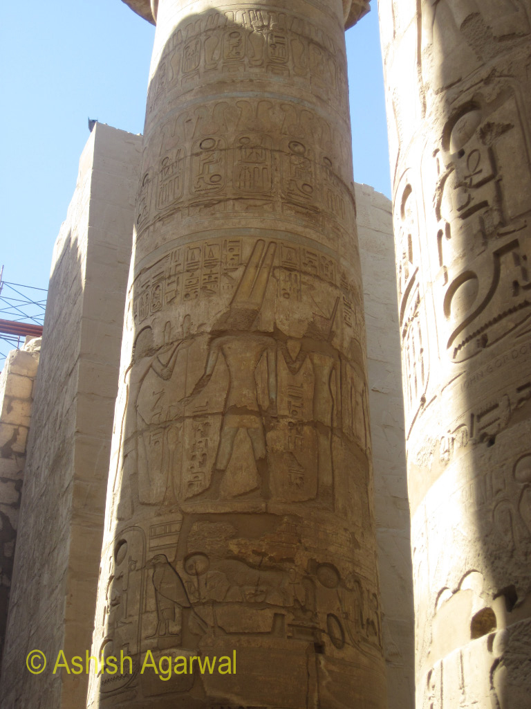 Image of pharaoh and others on a pillar inside the Hypostyle Hall in Karnak