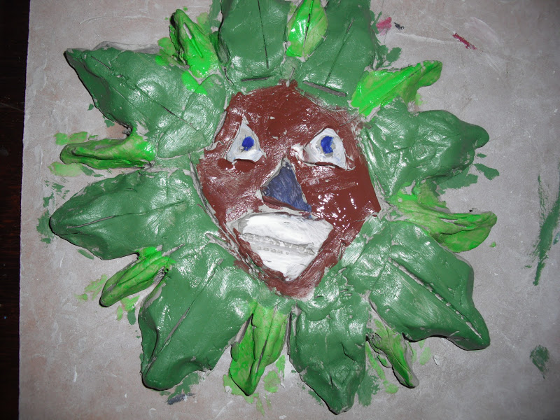 Year 5 making clay models of the UK legend - the Green Man!