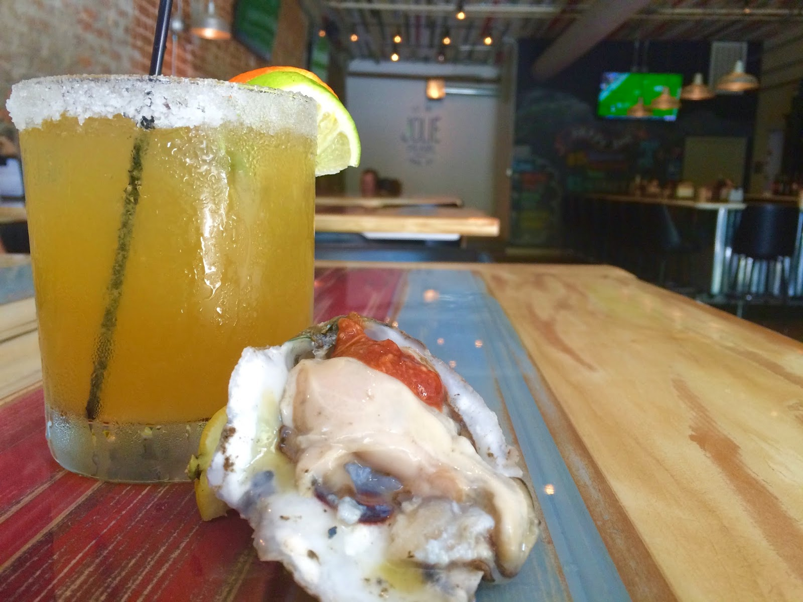 A Louisiana Gulf Oyster paired with a Fresh Margarita at Jolie Pearl