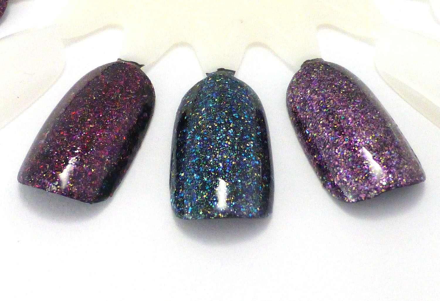 Micro glitters, one coat over black (left - right): Hera, Wanderlust, and Phoebe.