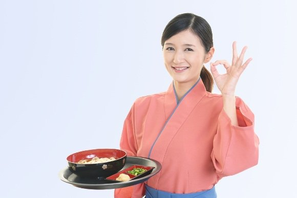 korean woman holding a food