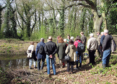 Jenny Price addressing the group by a pond in Jubilee Country Park