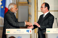Indian Prime Minister Narendra Modi (L) and French President Francois Hollande (R) shake hands during a news conference at the Elysee Palace in Paris, April 10, 2015. (Credit: Reuters/Charles Platiau) Click to Enlarge.