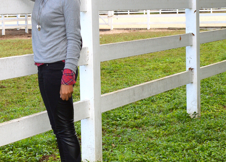 Fashion Blogger Anais Alexandre of Down to Stars in a Forever 21 elbow patch sweater, plaid buttondown , Tripp NYC leather patch pants near a horse stable