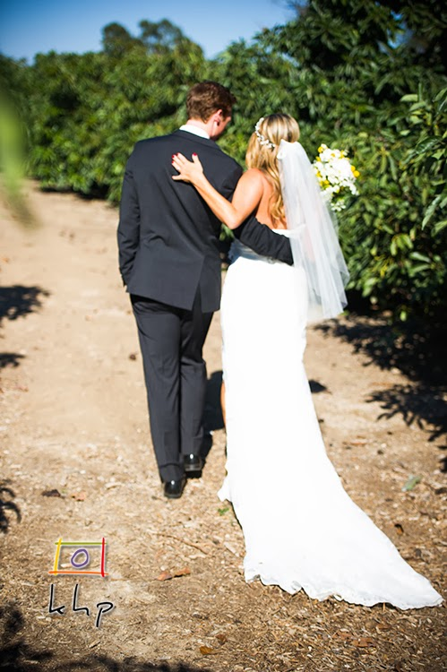 Sean & Kristyn walks the aisle after the ceremony at The Limoneira Ranch