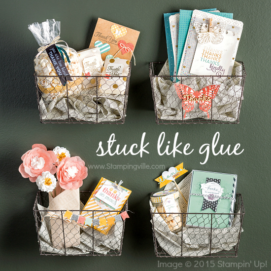 "Photo image of a variety of papercraft projects in baskets titled ""stuck like glue""."