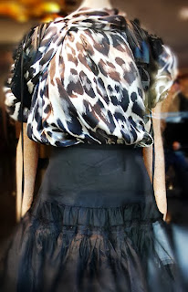 Painterly animal print top with leather shoulder harness at ikram.