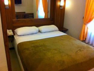tempat tidur hotel bukit dago