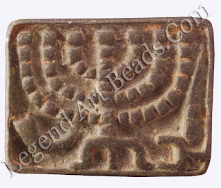 Jewish iconography was extremely rare in early Byzantine times. This bread stamp is cast with a menorah, shofar, lulav, and incense shovel.